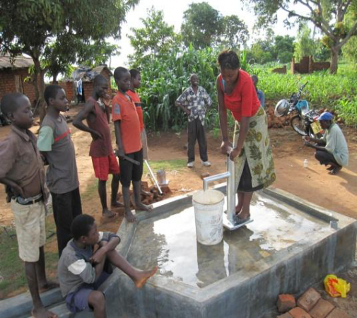 Drawing water from the well.
